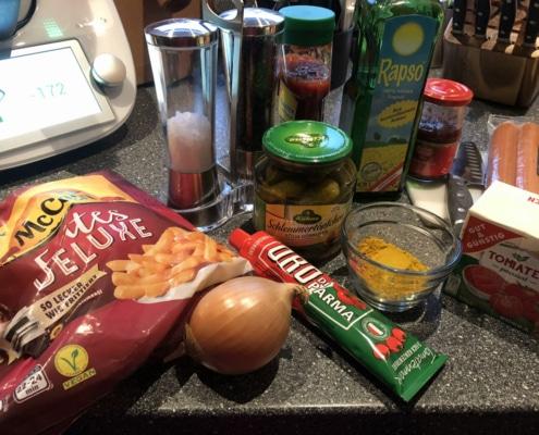 Pommes mit Currywurst Rezeptzutagen
